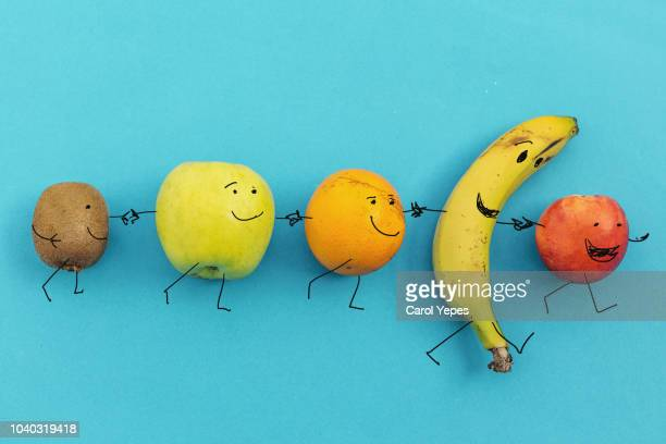 happy colorful fruits walking together - fun background stock pictures, royalty-free photos & images