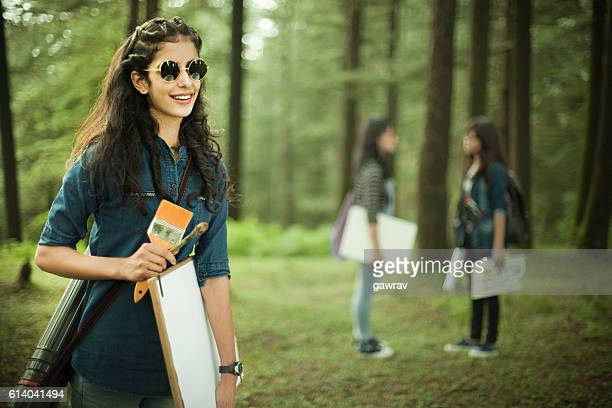 happy, confident, female fine art college students in outdoor location. - indian college girls stockfoto's en -beelden
