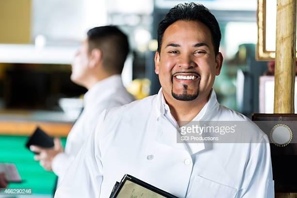 Happy confident Hispanic chef and restauranteur in local Tex-Mex restaurant