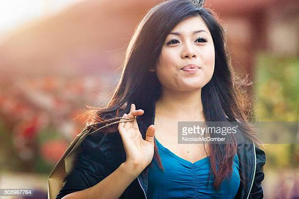 Happy confident young Indonesian woman just living it