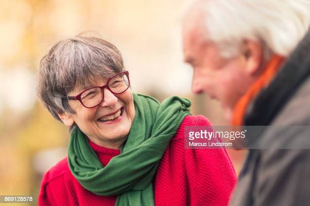 happy conversation - active senior woman stock photos and pictures