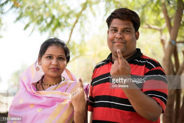 happy couple after casting their votes. - after stock photos and pictures