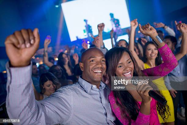 Happy couple at a karaoke party