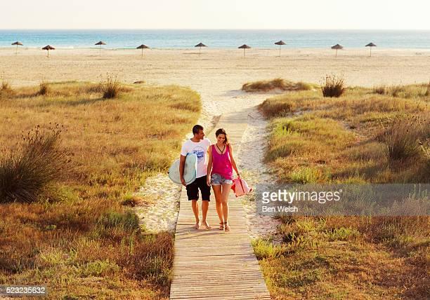 Happy couple at beach, Tarifa, Costa de la Luz, Cadiz, Andalusia, Spain