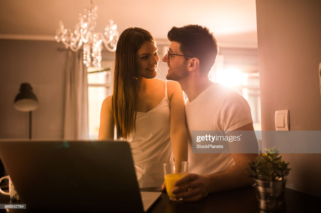 Happy couple at home in the morning : Stock Photo
