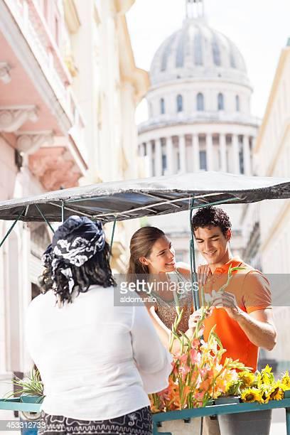Happy couple buying flowers