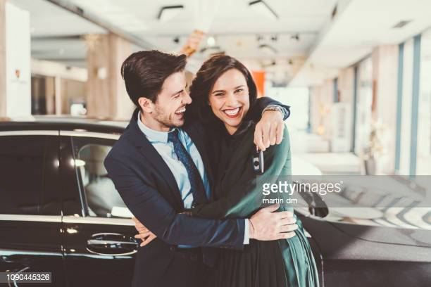 happy couple buying new car - new stock pictures, royalty-free photos & images