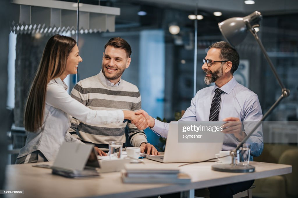 Happy couple came to an agreement with their insurance agent. : Stock Photo