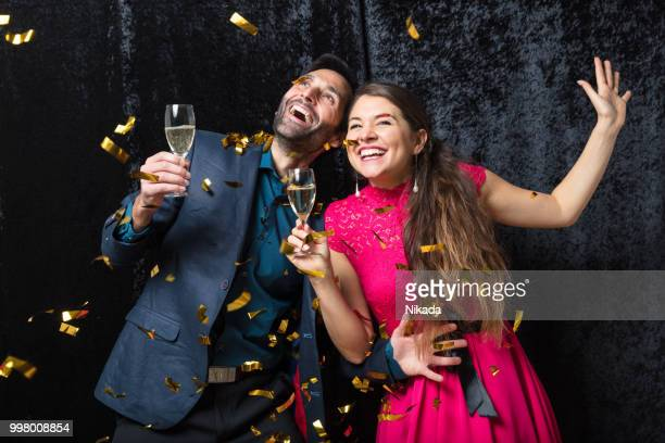 happy couple celebrating with champagne - evening ball stock pictures, royalty-free photos & images