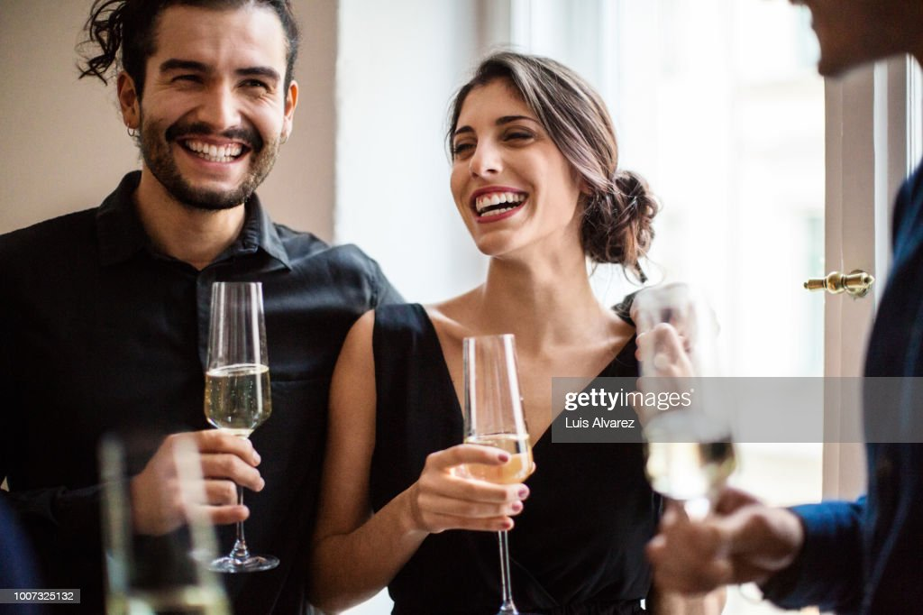 Happy couple champagne flutes during dinner party : Stock Photo