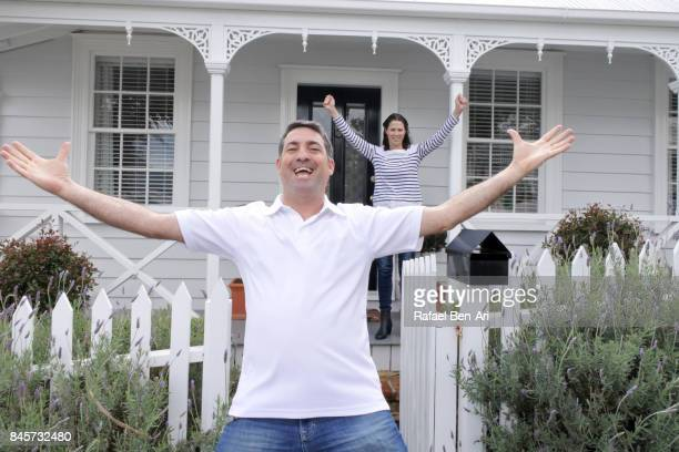 happy couple cheer with happiness in front of their new home. - rafael ben ari ストックフォトと画像