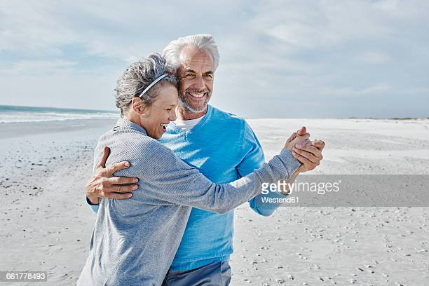 Happy couple dancing on the beach