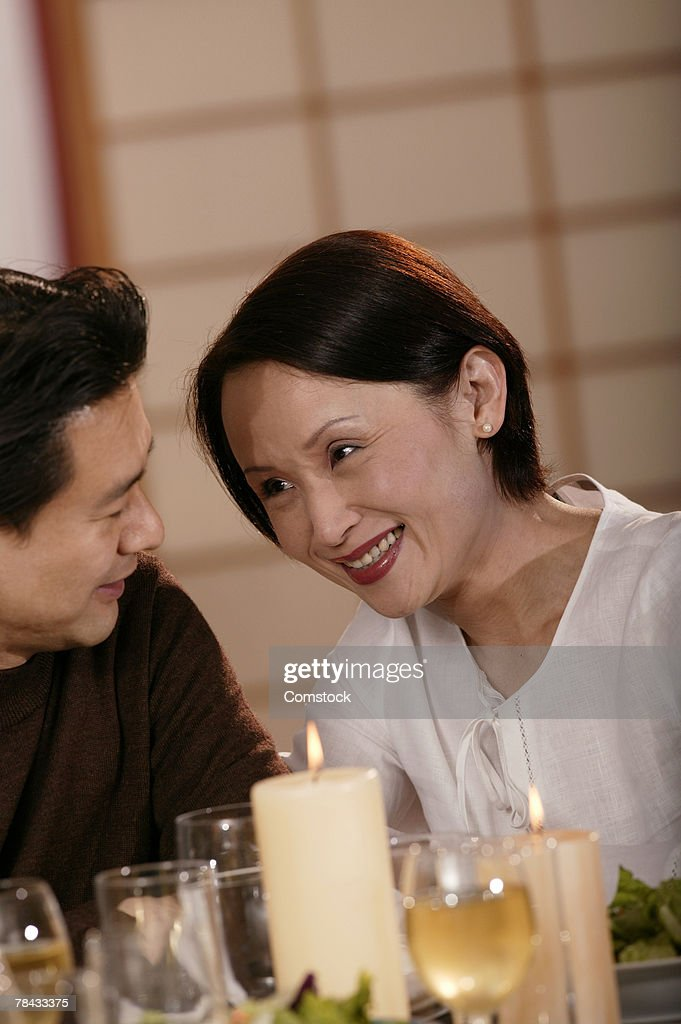 Happy couple dining by candlelight : Stock Photo