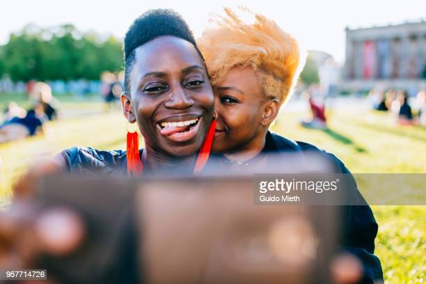 Happy couple doing selfie.
