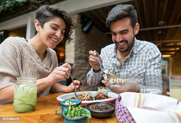 Happy couple eating at a restaurant
