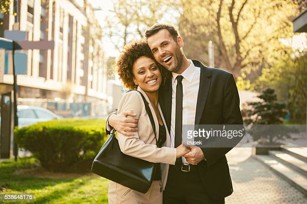 happy couple embracing outdoor - izusek stock pictures, royalty-free photos & images