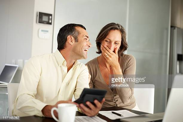 Happy couple enjoying a moment while discussing house budget