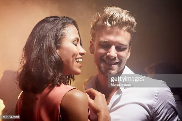 Happy couple enjoying at nightclub