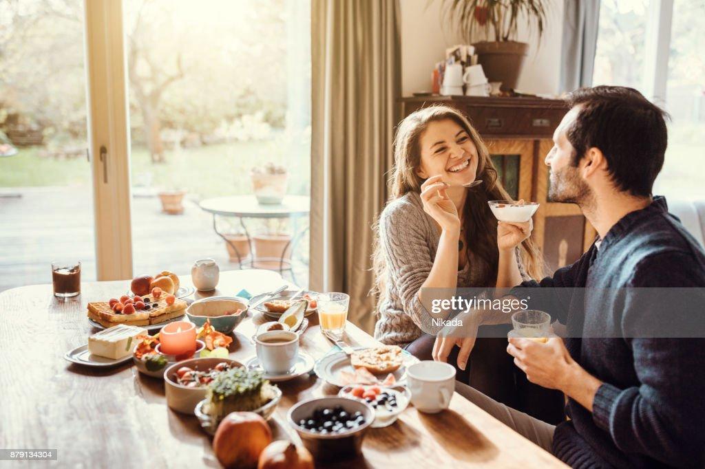 happy couple enjoying breakfast together : Stock Photo