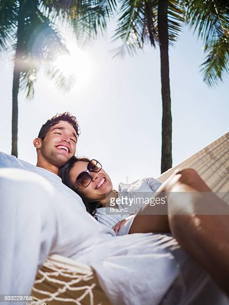 Happy couple enjoying in hammock.