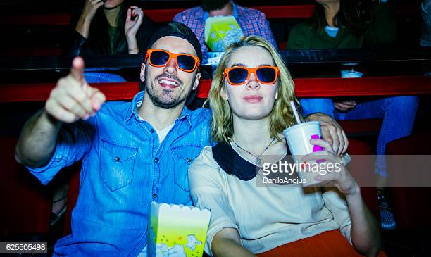 happy couple enjoying in the cinema watching a 3d movie