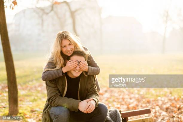 happy couple, enjoying in the local park - milan2099 stock photos and pictures
