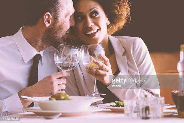Happy couple flirting at dinner in the restaurant