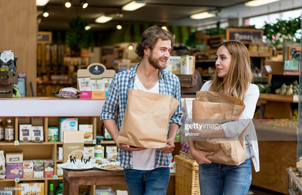 Happy couple grocery shopping : Stock Photo
