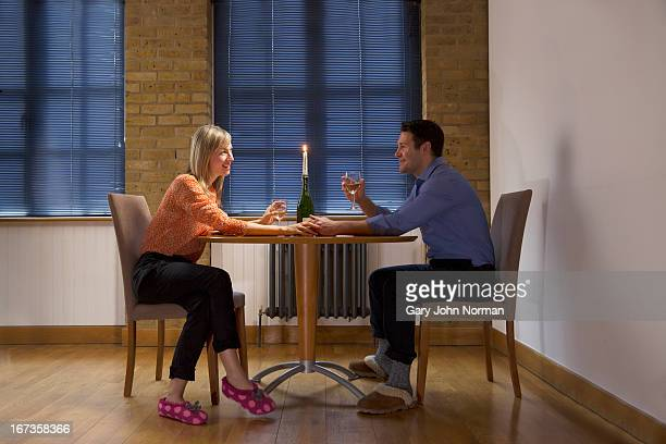 happy couple have dinner in apartment