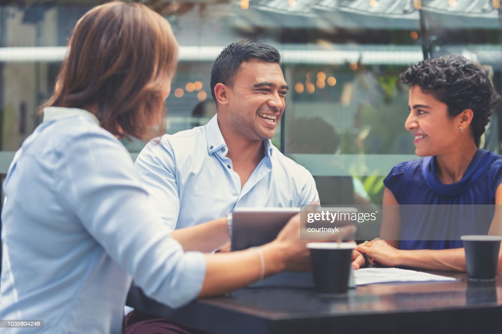 Happy couple having a business meeting with a financial advisor. : Stock Photo