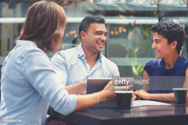 happy couple having a business meeting with a financial advisor. - business finance and industry stock pictures, royalty-free photos & images