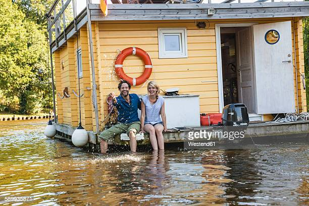 happy couple having a trip on a house boat - houseboat stock pictures, royalty-free photos & images