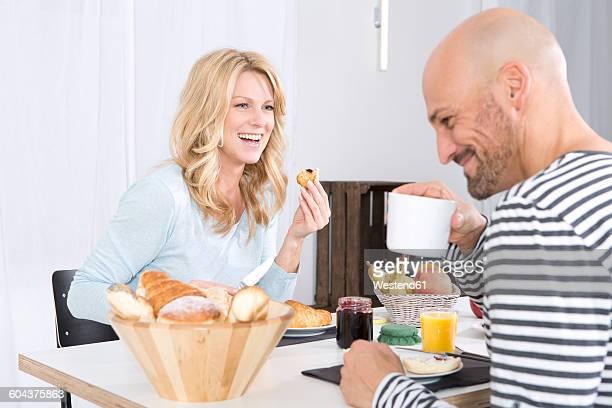 Happy couple having breakfast at hoome