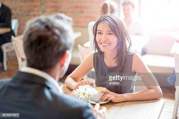 Happy couple having coffee at a restaurant