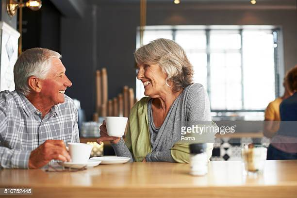 Happy couple having coffee at restaurant