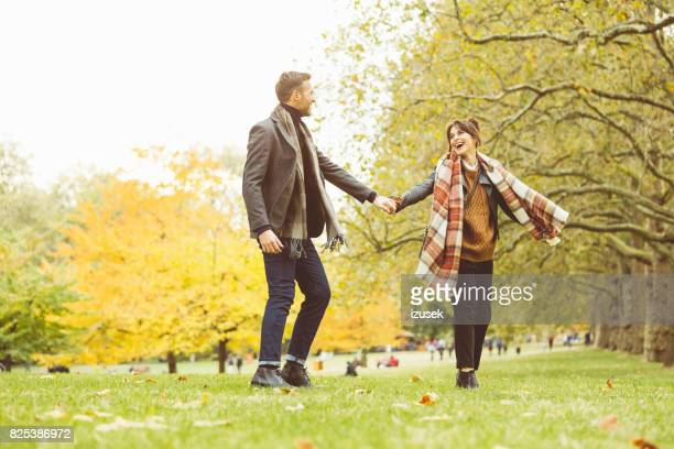 happy couple having fun at public park - hyde park london stock photos and pictures