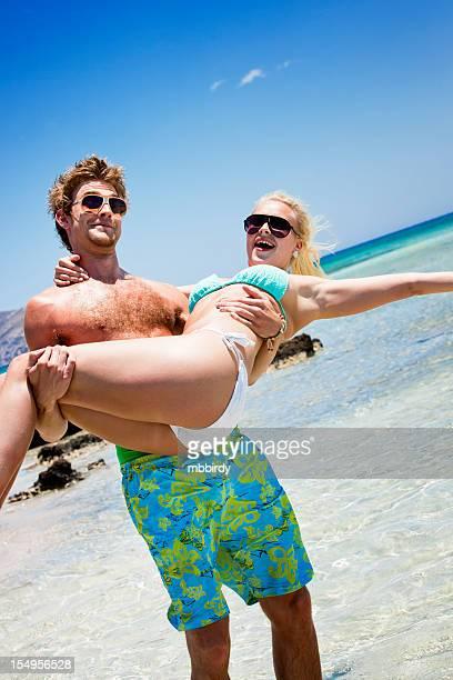 Happy couple having fun at sea coast