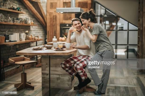 happy couple having fun during breakfast time at home. - caffè bevanda foto e immagini stock