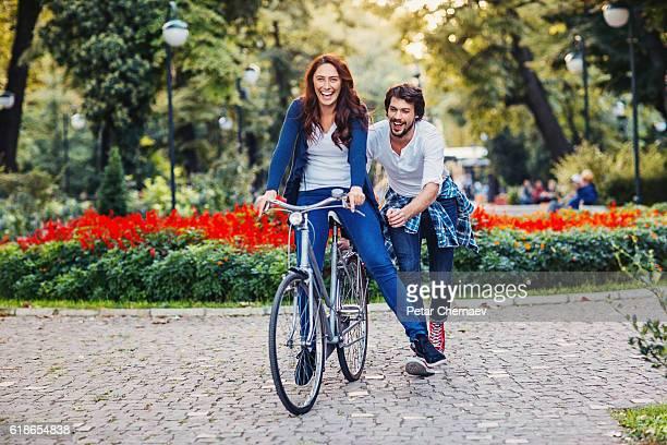 Happy couple having fun in the park