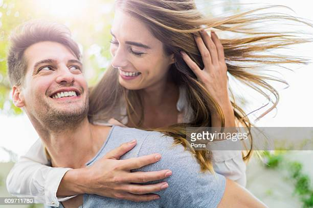 Happy couple having fun on sunny day