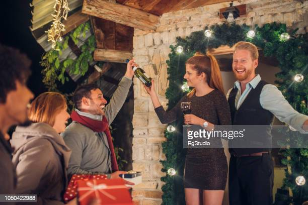 happy couple having guests - hello december stock pictures, royalty-free photos & images