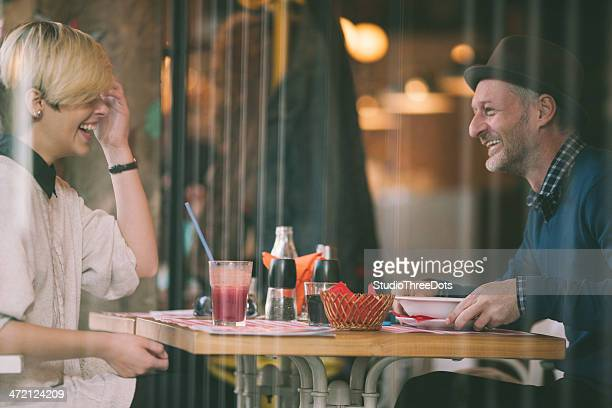 Happy couple having lunch in restaurant