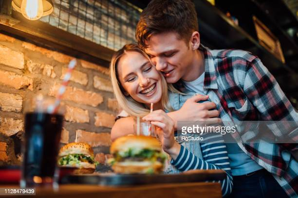 happy couple hugging - valentines day dinner stock pictures, royalty-free photos & images