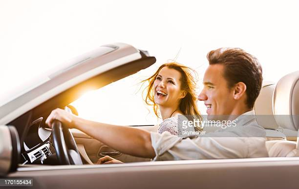 Happy couple in a car.