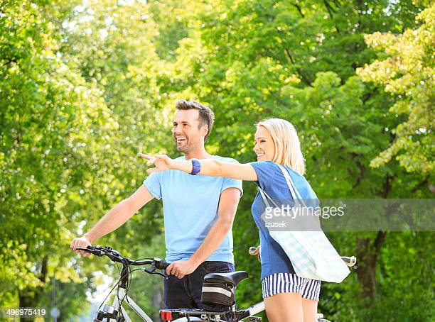 happy couple in a park - izusek stock photos and pictures