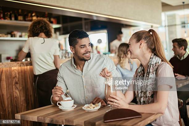 Happy couple in cafe
