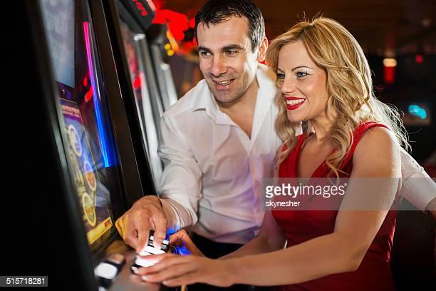 Happy couple in casino.