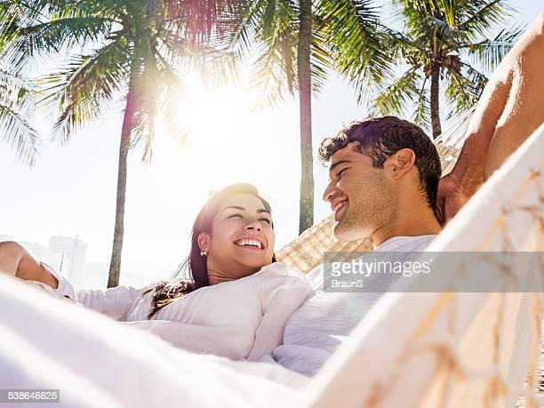 Happy couple in hammock.