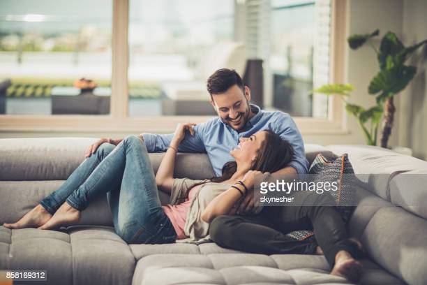 happy couple in love resting on the sofa at home and communicating. - women of penthouse stock photos and pictures