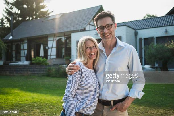 Happy couple in the garden of their country house